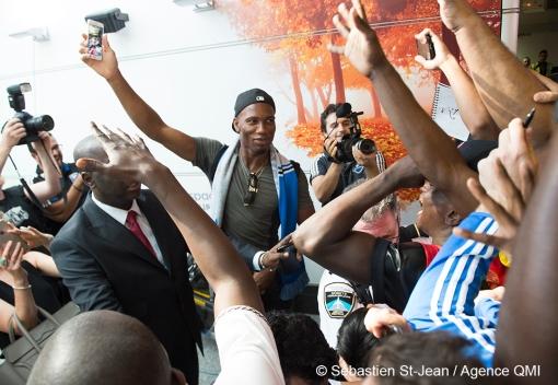 Didier Drogba, nouveau joueur de soccer de l'Impact de Montréal, à son arrivée à l'aéroport Montréal-Trudeau, à Montréal, Québec, Canada, le mercredi 29 juillet 2015. SÉBASTIEN ST-JEAN/AGENCE QMI